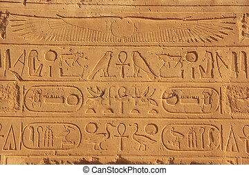 Ancient hieroglyphics on the walls of Karnak temple complex,...