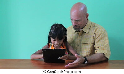 Daughter Shows Dad Tablet - A cute little 7 year old girl...