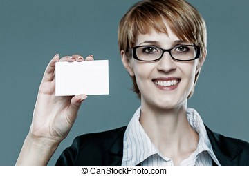 Young business woman showing her business card