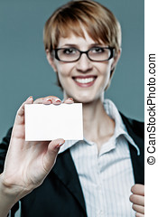 Ambitious business woman showing her business card