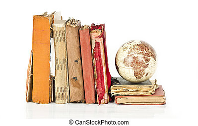 Old books and Earth globe - Pile of old books and earth...