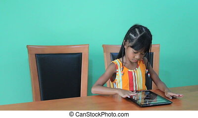 Father Help Girl Use Digital Tablet - A father walks in and...