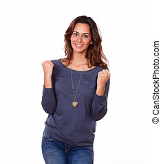 Young woman in blue t-shirt celebrating - Portrait of a...