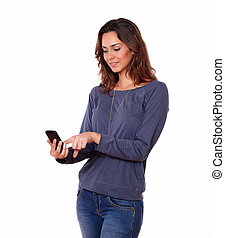 Charming young woman texting on cellphone - Portrait of a...