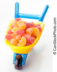 toy wheelbarrow full of sugary jellies