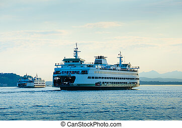 Washington State Ferries sail from Seattle to Bainbridge and...