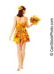 Back side view Autumn woman in fashion dress of maple leaves holding bouquet leaves. Isolated