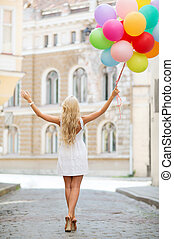 Woman with colorful balloons - summer holidays, celebration...