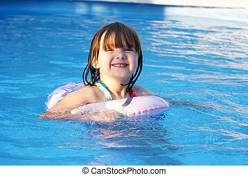 Enjoying Summer - A happy five year old girl enjoys her...