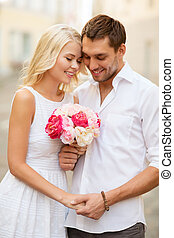 couple with flowers in the city - summer holidays and dating...