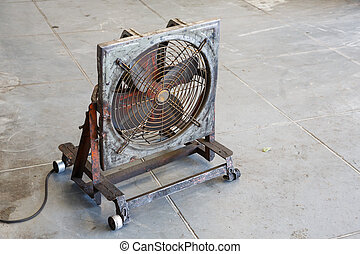 Fan in garage - Close up old and dirty electric fan in...