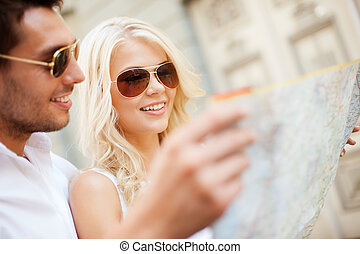 couple with map in the city