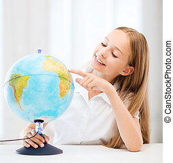 Student girl with globe at school - education and school...