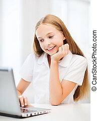 Girl with laptop pc at school - education, school,...