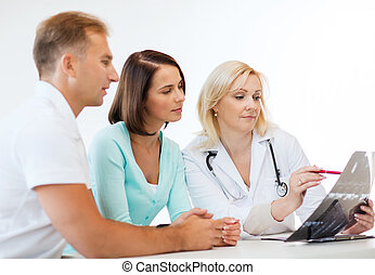 Doctor with patients looking at x-ray - Healthcare and...