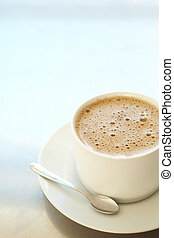Cafe latte in coffee cup - Fresh foamy cafe latte in white...