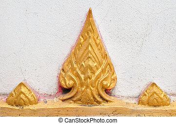 A symbol of Thai Buddhist on wall