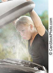 overheat - portrait of young beautiful woman with broken car...