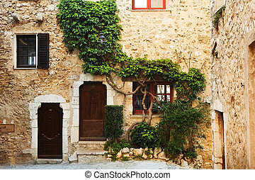 Village of St Paul - Buildings with windows and doors in the...