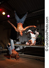 Three hip-hop dancers - Three freestyle hip-hop dancers in a...