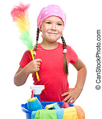 Young girl is dressed as a cleaning maid, holding static...