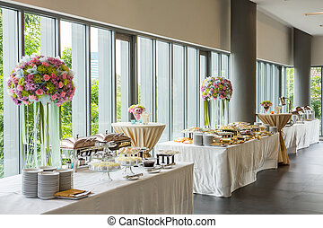 Buffet line in luxury party decoration with beautiful flower...