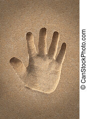 palmhand icon or sign creation in beach sand - concept photo...