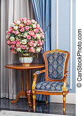 Elegance armchair with beautiful flower bouquet in luxury...