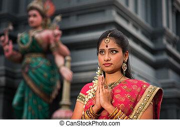 Young Indian woman praying - Beautiful young Indian woman in...