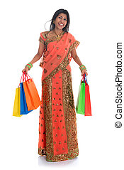 Indian woman in sari dress shopping - Portrait of full...