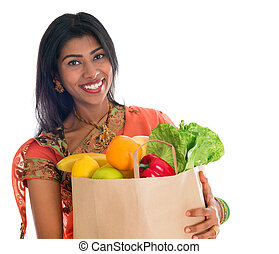 Indian woman in sari dress groceries shopping - Happy...
