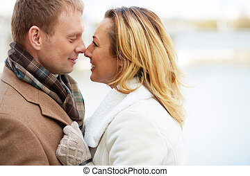 Closeness - Portrait of affectionate couple touching by...