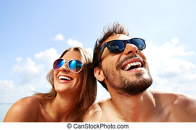 Joyful couple - Relaxed young dates having fun on summer day