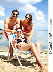 Beach vacation - Relaxed young friends having rest on the...