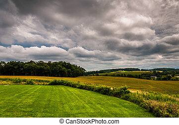 Storm clouds over farm fields in rural York County, Pennsylvania.