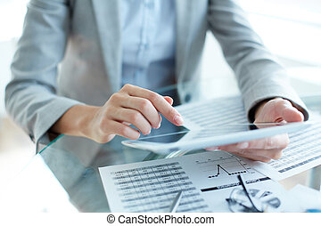 Office work - Close-up of young businesswoman hands working...