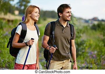 Summer recreation - Portrait of couple of happy hikers in...