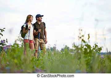 Enjoying nature - Portrait of two trippers standing in the...