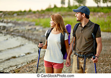 Couple on vacation - Portrait of couple of happy hikers on a...