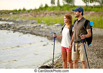 Admiring scenery - Portrait of couple of happy hikers...
