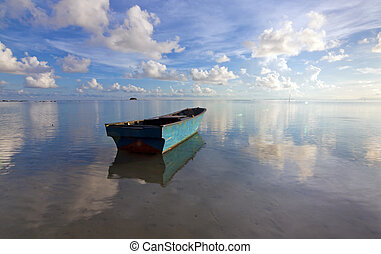 Lonely boat with blue sky at Sabah, Borneo, Malaysia