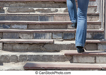 woman rises up on the destroyed steps