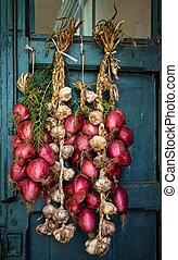 Bunch of red onions from Tropea, - The south Italy, area...