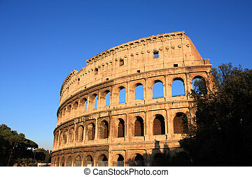 Colosseum in Rome - Colosseum over blue sky - Rome, Italy....
