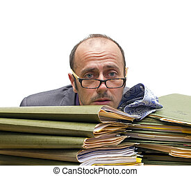 hard work - man making a burnout over a pile of folders