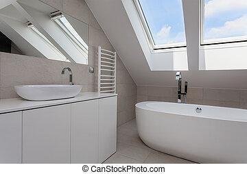 Urban apartment - bright bathroom interior on the attic