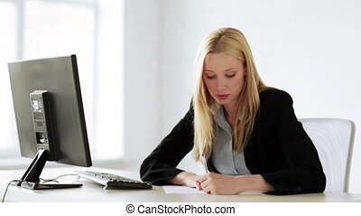 business woman working with papers in office - attractive...