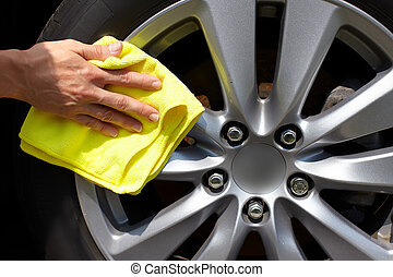 Car washing - Hand with microfiber cloth cleaning car