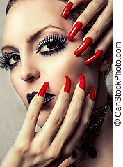 Beautiful Make-up and long red Nails - Beauty woman with...