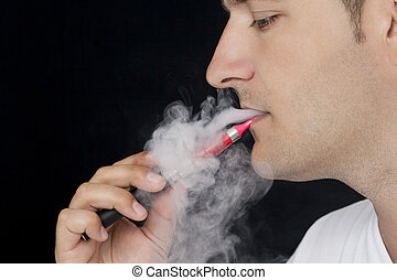 Young man smoking E-cigarette - Young man smoking an...